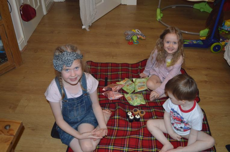 about to tear into their cupcakes and crisps, note Judah covering his potty training modesty