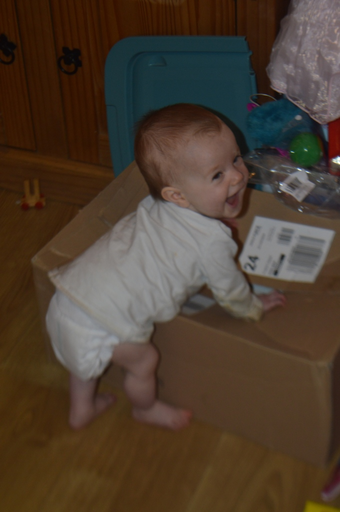 pulling up to stand, milestones, 10 months old, baby, standing